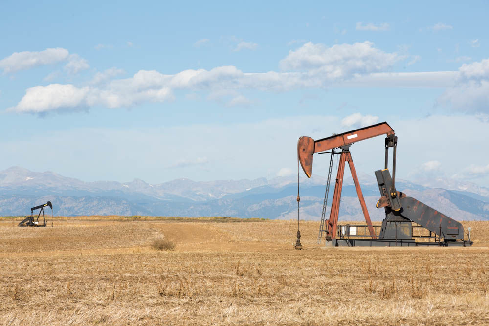 commercial photographer, greeley, colorado, commercial photography, pump jack, oil, mountains
